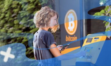 Woman with bitcoin atm